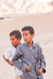 SHARM EL SHEIKH, EGYPT - JULY 9, 2009. Two sad child standing in the desert, and looking into the distance Stock Image