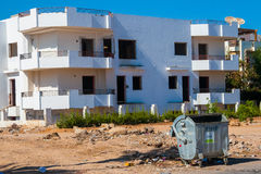 SHARM EL SHEIKH, EGYPT - JULY 9, 2009. Unfinished buildings in downtown with trash Royalty Free Stock Photography