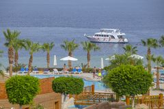 People rest in swimming pool near red sea in beach hotel, Sharm El Sheikh, Egypt stock photo