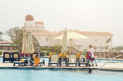 Sharm El Sheikh, Egypt May 07, 2019: people sunbathe and swim in the pool stock images