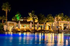Sharm el-Sheikh, Egypt, 02/25/2019. Night landscape, interior of the hotel overlooking the pool, houses and palm trees stock photography