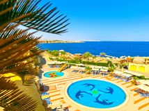 Sharm El Sheikh, Egypt - September 25, 2017: The view of luxury hotel Dreams Beach Resort Sharm 5 stars at day with blue. Sharm El Sheikh, Egypt - September 25 Royalty Free Stock Photos