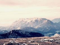 Sharp Alps peaks, rocks without people. View over Alpine rocks above deep vallyes to far horizon Royalty Free Stock Image
