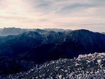 Sharp Alps peaks, rocks without people. View over Alpine rocks above deep vallyes to far horizon Stock Image
