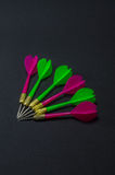 Sharp arrow on black background Royalty Free Stock Images