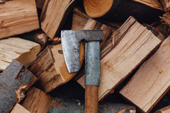 Sharp ax on a pile of chopped wood Royalty Free Stock Photo