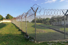 Sharp barbed wire on security fence protecti secure private spac. E within open space Royalty Free Stock Photo