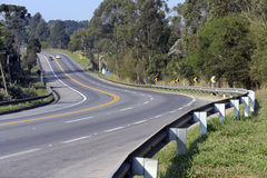 Sharp bend in the highway. SAO ROQUE, SP, BRAZIL - AUGUST 22, 2015 - Sharp bend in the highway in the state of São Paulo stock image