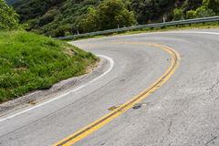 Sharp Bend in Road. Road banks in a sharp bend in southern California mountains near Los Angeles royalty free stock photos