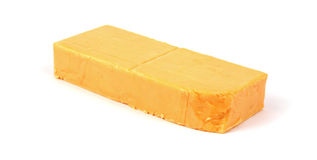 Sharp cheddar cheese bar Stock Photography