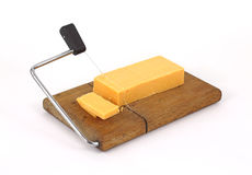 Sharp cheddar cheese being sliced Stock Images