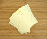 Sharp cheddar cheese on cutting board Stock Photo