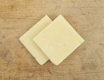 Sharp cheddar cheese on an old cutting board Stock Photography