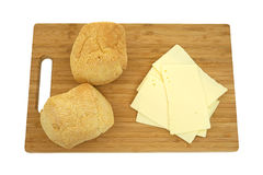 Sharp cheddar cheese with rolls Royalty Free Stock Photos