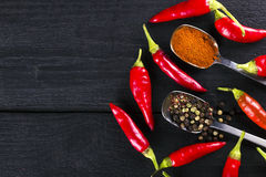 Sharp Chile pepper in pods, bell pepper, ground pepper.  Stock Image