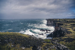 Sharp cliffs in stormy weather Stock Image
