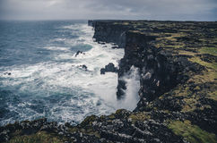 Sharp cliffs in stormy weather Stock Photo
