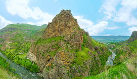 The sharp coned rock at Tmogvi. The sharp coned rock with the ruins of the Tmogvi Castle on the slope, Samtskhe-Javakheti Region, Georgia royalty free stock images