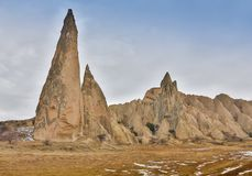 The sharp cones of rock formations boasts unique colors and shapes, Cappadocia, Turkey. stock photography