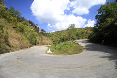 Sharp curve of asphalt road. At some road in the nort of thailand stock photos