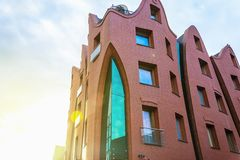 Sharp curve hotel building architecture facade in Gdansk, Poland. Red brick royalty free stock image