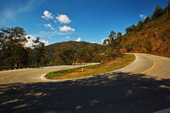 Sharp curve on a mountain road royalty free stock photography