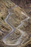 Sharp curve on mountain road in Himalaya mountains, Ladakh region. India stock photo