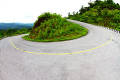Sharp curve of road. Sharp curve of asphalt road royalty free stock photography