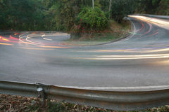 Sharp curve road. With car light line stock images
