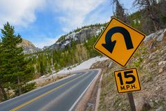 Sharp Curve Road. Colorado Mountain Highway and Sharp Curve Warning Sign Royalty Free Stock Image