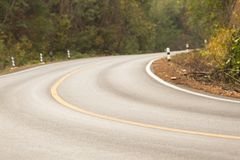 Sharp curve road in forest hill. View of sharp curve road in forest hill royalty free stock photo
