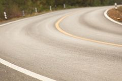 Sharp curve road in forest hill. View of sharp curve road in forest hill stock photography