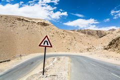 Sharp curve on the road in Ladakh, India Stock Photo