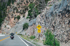 Sharp Curve Road and Sharp Curve Warning Sign. Sharp Curve Road and Sharp Curve Warning Sign on the mountain in USA royalty free stock images