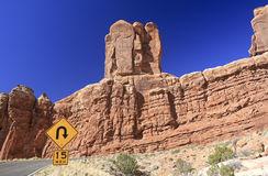Sharp curve sign in Arches. National Park royalty free stock photo