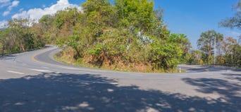 Sharp curve u-turn road up hill to the mountain. At Doi Suthep Chiangmai Thailand royalty free stock photo