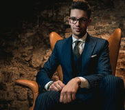 Sharp dressed dandy in a chair Royalty Free Stock Photo