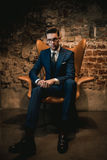 Sharp dressed dandy in a chair Stock Photos