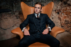 Sharp dressed dandy in a chair Royalty Free Stock Images