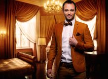 Sharp dressed fashionist in luxury apartment Stock Photography