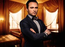 Sharp dressed fashionist in luxury apartment Royalty Free Stock Image
