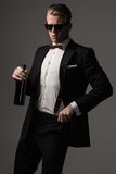 Sharp dressed man with bottle of wine Stock Photos