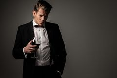Sharp dressed man with glass Royalty Free Stock Photos