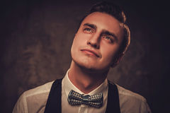 Sharp dressed man wearing bow tie showing emotions Stock Photography