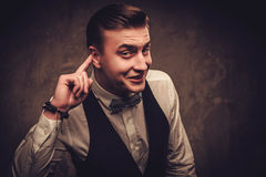 Sharp dressed man wearing bow tie showing emotions Royalty Free Stock Photography