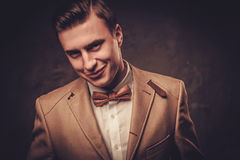 Sharp dressed man wearing jacket and bow tie Stock Images