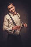 Sharp dressed man wearing suspenders and bow tie Royalty Free Stock Photography