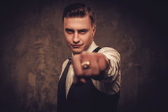 Sharp dressed man wearing waistcoat and bow tie pointing with his finger Stock Photography