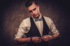 Sharp dressed man wearing waistcoat and bow tie Stock Photo
