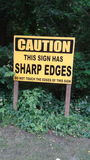 Sharp edges. A funny sign on a road about sharp edges royalty free stock photo
